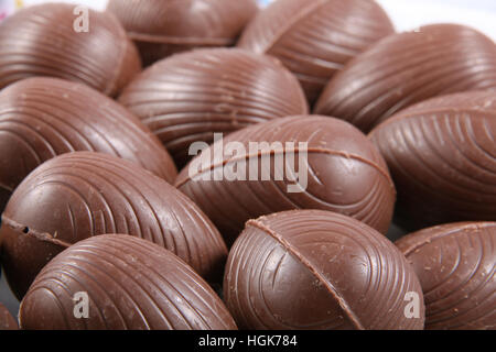 Close up of chocolate easter eggs, with the wrappers off ready to eat. - Stock Photo