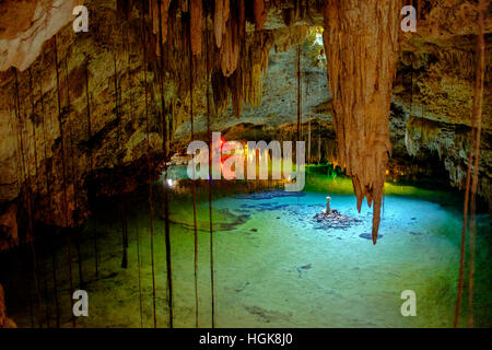 Mexican Cenote, called Tak Be Ha, showing the underground river, the stalagmites and stalactites. Yucatan province, - Stock Photo