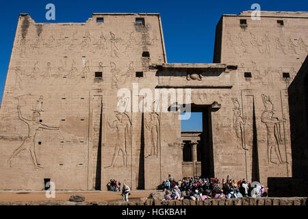 Group of tourists at Temple of Edfu, dedicated to the god Horus, on the Nile River in upper Egypt  One of the best preserved. Stock Photo