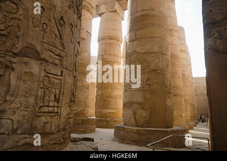 Carved pillars, Built in Yellow Limestone, View of the great hypostyle hall in the Precinct of Amon Re,  Karnak - Stock Photo