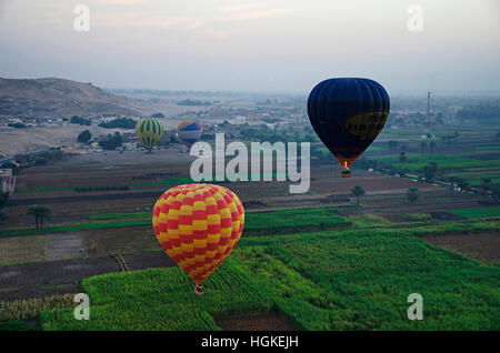 Aerial view of Luxor city and hot air balloons, West bank of Luxor, Egypt - Stock Photo