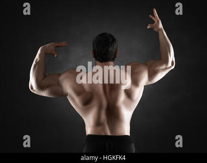 Close up of sports man's muscular back isolated - Stock Photo