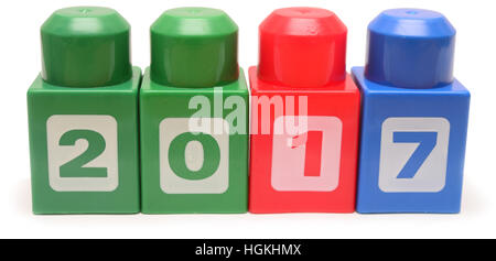 Colorful stacked toy plastic building blocks isolated on white background - Stock Photo