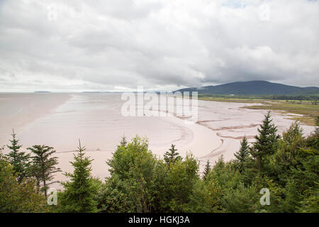 The view of St. Martins village Bay of Fundy beach famous for it's high sea tides (New Brunswick, Canada). - Stock Photo