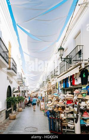 Nerja, Spain - June 20, 2015: People walking along one of narrow streets in Nerja - Stock Photo