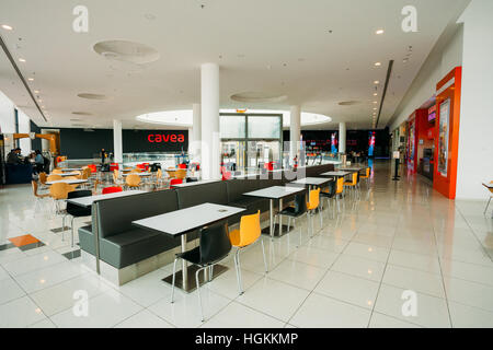 Tbilisi, Georgia - May 24, 2016: Free food court tables stand in a shopping center mall East Point - Stock Photo