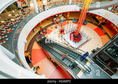Tbilisi, Georgia - May 24, 2016: People in motion in escalators at the modern shopping mall East Point - Stock Photo