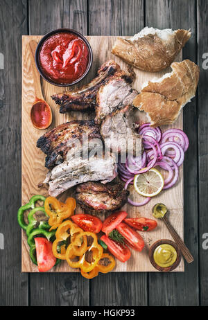 Sliced grilled pork rustic flat lay - Stock Photo