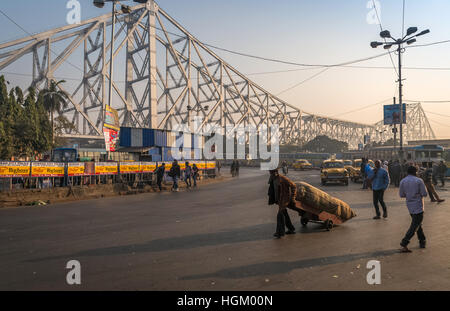City road traffic near Howrah bridge on a foggy morning. Photograph taken on the road close to Howrah Railway Station, - Stock Photo