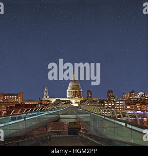 The Millennium Bridge and the Great Dome of St. Paul's cathedral in London against a clear night sky. - Stock Photo