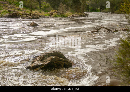 Rushing waters and granite rock in the Swan River at Bell Rapids in Brigadoon, Western Australia. - Stock Photo