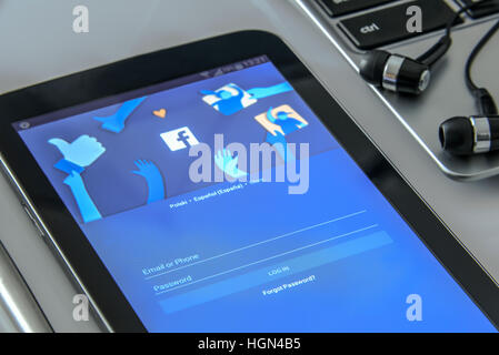 Krynica Poland - November 03, 2016: Facebook app in a mobile phone, close to a laptop. Facebook is one of the most - Stock Photo