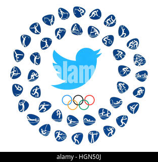 Kiev, Ukraine - August 03, 2016: Twitter bird logo with Olympic Games Rings and kinds of sport of the 2016 in Rio - Stock Photo