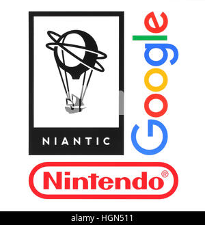 Kiev, Ukraine - August 23, 2016: Collection of popular companies logos printed on paper: Niantic, Nintendo and Google, - Stock Photo