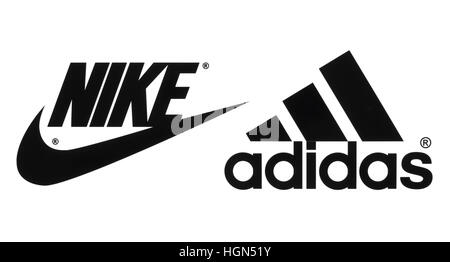Kiev, Ukraine - September 26, 2016: Collection of popular manufactures sports shoes logos printed on paper: Nike - Stock Photo
