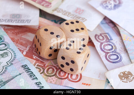 Ruble banknotes and wooden dice on them. Concept image. Close up. - Stock Photo