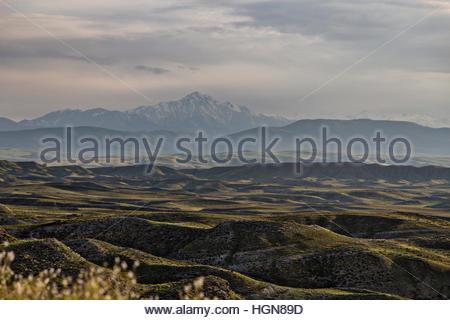 Peaceful mountain landscape at sunset. - Stock Photo