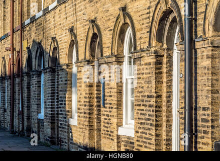 Victorian Terraced houses in Saltaire, West Yorkshire, UK. - Stock Photo
