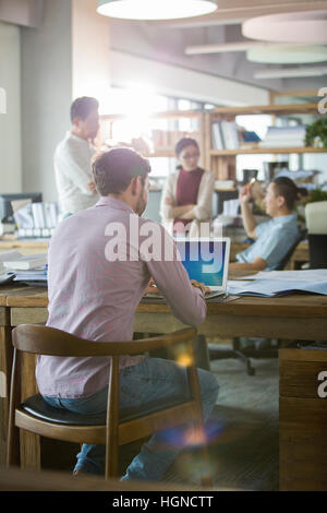 Architects working in the office - Stock Photo