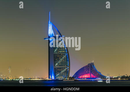 Night view of Burj al Arab and Jumeirah Beach Hotel, Dubai, United Arab Emirates - Stock Photo