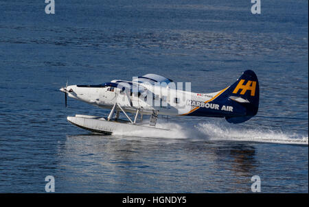A De Havilland Otter Harbour Air seaplane takes off from Vancouver harbour, British Columbia, Canada. - Stock Photo