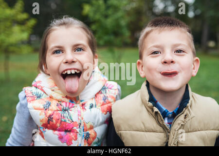 Making funny faces in the park - Stock Photo