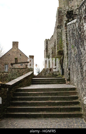 The Island of Mont St Michel on a cloudy & wet day in Normandy, France (St. michaels mount) - Stock Photo