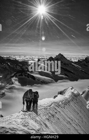 Climbers on the Monch, Switzerland - Stock Photo