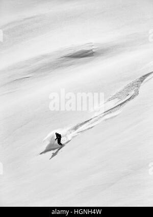 Off piste skiing above Arolla, Switzerland - Stock Photo
