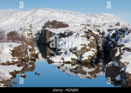 Nikulasargja canyon in the snow in winter, Thingvellir National Park, Iceland - Stock Photo