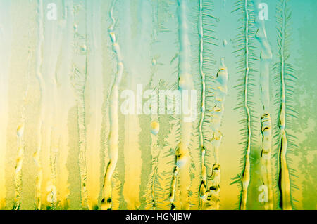Transparent ice formations and frost on glass as background - Stock Photo