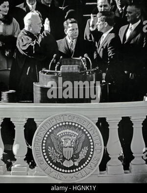 United States President John F. Kennedy is sworn-in as the 35th President of the United States by Chief Justice - Stock Photo