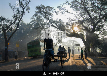 BANGLADESH, Khulna District, morning mist at road in village, Bus and bicycle rikshaw / BANGLADESCH Khulna , Menschen, - Stock Photo