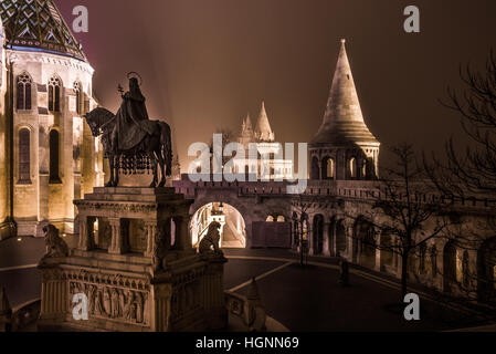 St. Stephen Statue at Fishermen's Bastion Castle Hill District (Varhegy), Buda, Budapest, Hungary by Night - Stock Photo