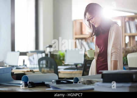 Female architect working in the office - Stock Photo