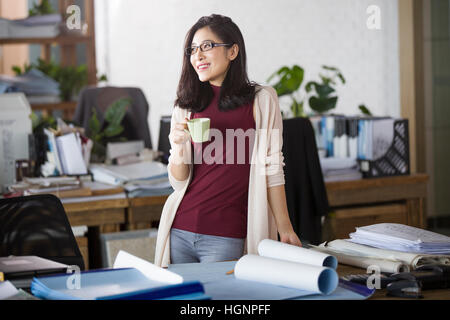 Female architect relaxing in the office - Stock Photo