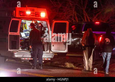 The scene of an accident on a rural road near Modesto California where after heavy rains. ponding on the road made - Stock Photo