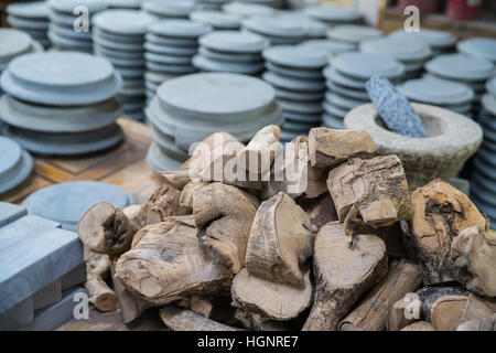 Heap of Kyauk pyin stone slab and Rhanaka wood for traditional cosmetic for using with Thanaka, popular for Burmese - Stock Photo