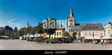 XANTEN, GERMANY - SEPTEMBER 07, 2016: Unidentified individuals enjoy the scenic marketplace with St. Victor's Cathedral - Stock Photo