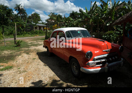 Vinales (Viñales), Cuba. Classic vintage 1950s American Chevrolet car parked in the countryside - Stock Photo