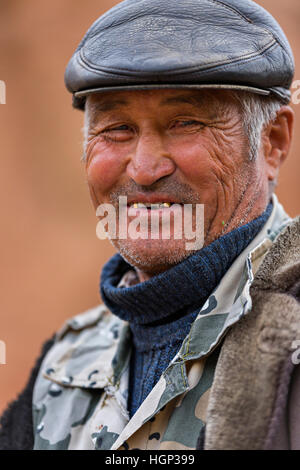 A man from Kazakhstan smiling. - Stock Photo