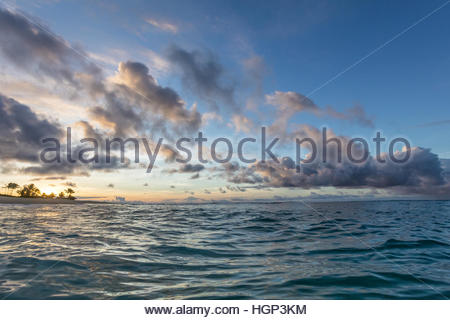 Sunrise over the ocean at Sandy beach park, Oahu. - Stock Photo