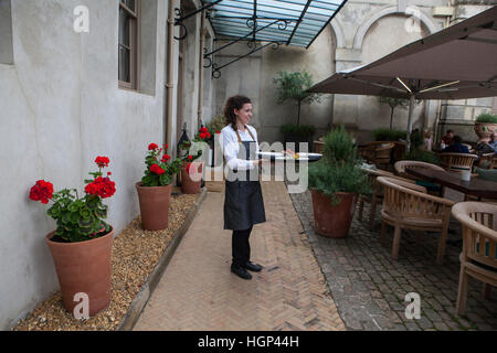 The Patio section of the Restaurant at The Astor Grill. - Stock Photo