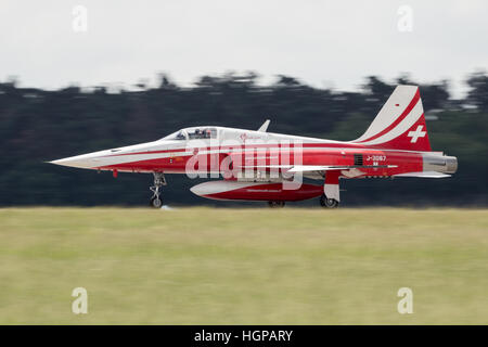 Patrouille Suisse F-5 fighter jet landing at the International Aerospace Exhibition ILA. - Stock Photo