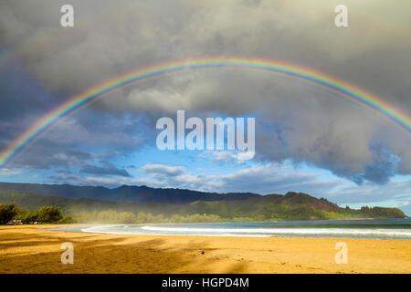 Rainbow  over Hanalei Bay on Kauai - Stock Photo