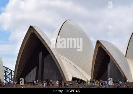 The Sydney Opera House SOH on Bennelong Point next to the Sydney Harbor Bridge and Harbor in Australia, New South - Stock Photo
