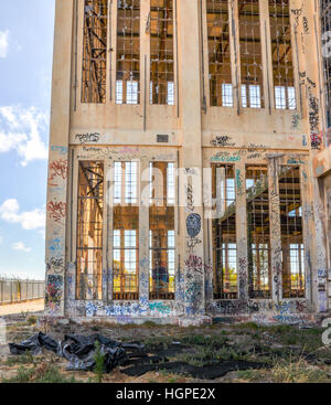 Old abandoned South Fremantle Power Station with youth tagging, broken windows and empty shell in North Coogee,Western - Stock Photo