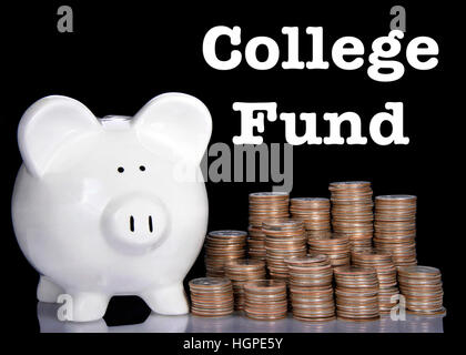 white piggy bank on a black background with stacks of quarters building up beside it reflecting on table, college - Stock Photo