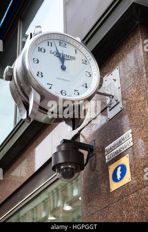HELSINKI, FINLAND - CIRCA SEP, 2016: It is almost twelve hours on facade clock on street Aleksanterinkatu. Aleksanterinkatu - Stock Photo