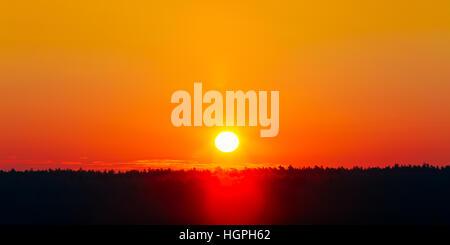 Panorama. Sun Over Horizon, Sunset, Sunrise Background. Sunset Over Dark Ground Forest. Panorama - Stock Photo